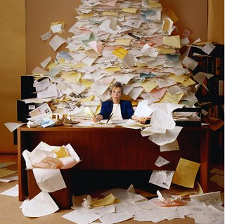 Overwhelmed-lady-desk